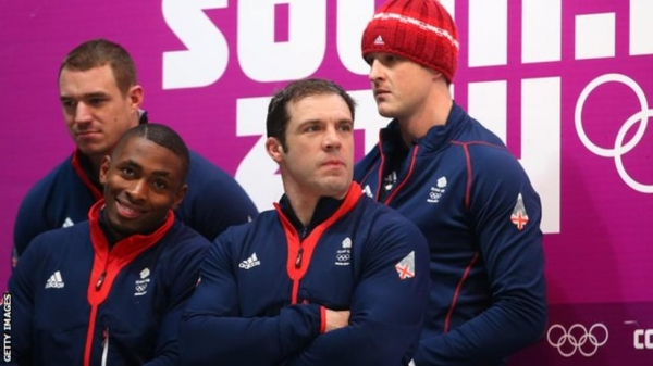 The British bobsleigh four-man team watch results come in in Sochi