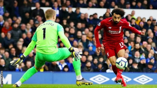 Everton's Jordan Pickford saves from Mohamed Salah during a Merseyside derby at Goodison Park in March 2019