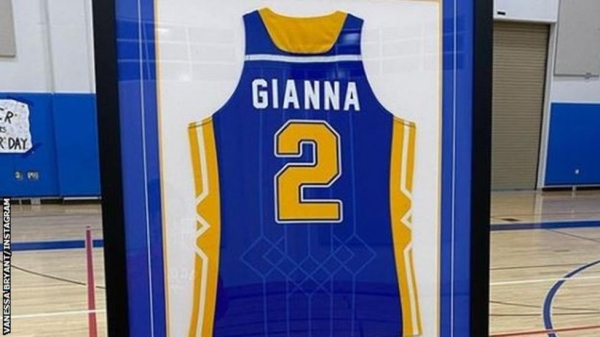 Gianna Bryant's jersey is being displayed on the wall in the school gym
