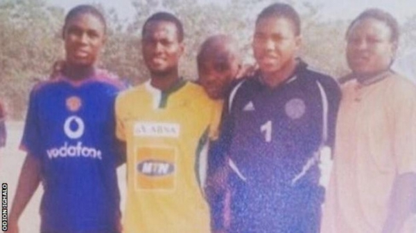 Ighalo (left) was picture wearing a Manchester United shirt during his childhood