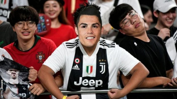 A fan dressed up as Cristiano Ronaldo in the crowd
