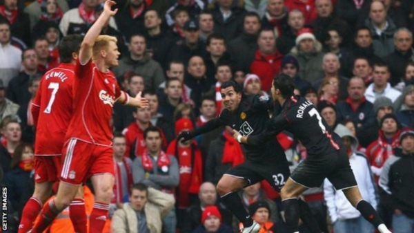 Carlos Tevez scores for Manchester United against Liverpool at Anfield