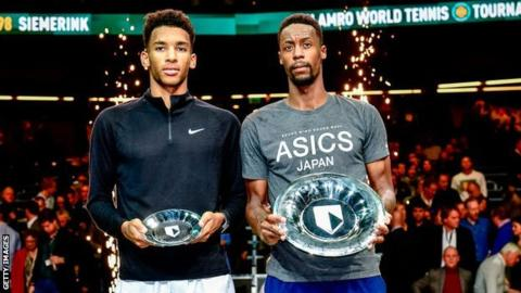 Gael Monfils (r) after beating Felix Auger-Aliassime to win the Rotterdam Open in 2020