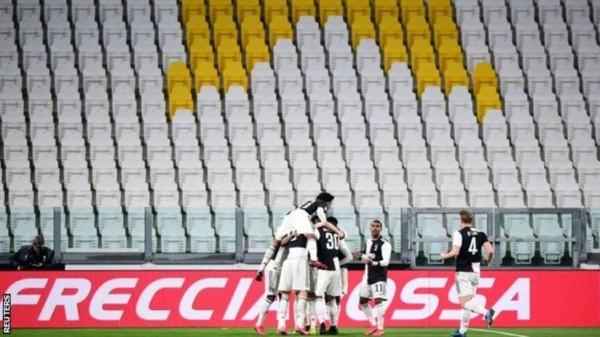 Juventus celebrate a goal in their match against Inter Milan, which was played without fans in the stadium