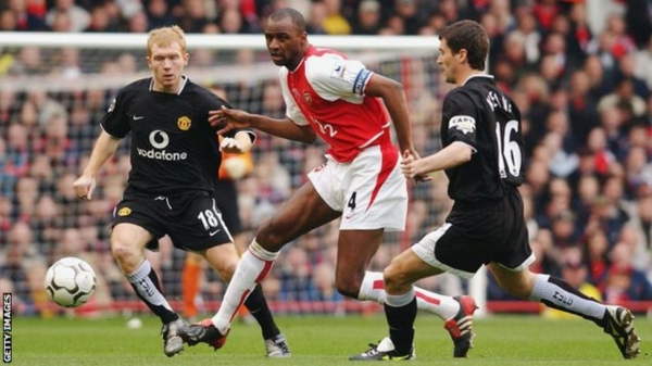 Patrick Vieira playing for Arsenal against Manchester United