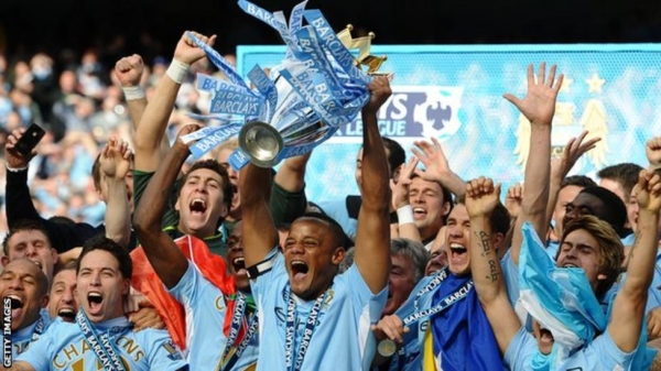 Vincent Kompany lifting the Premier League trophy in 2012