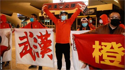Fans greated the team as they arrived in Wuhan via train