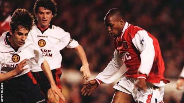 Ian Wright (right) in action against Manchester United in 1997