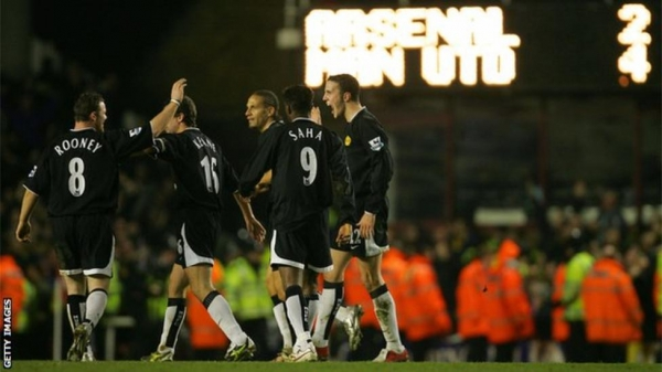 Manchester United players celebrate at High bury in 2005