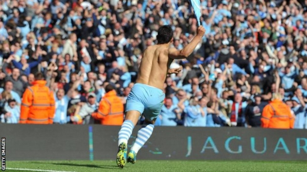 Sergio Aguero celebrates after scoring against QPR