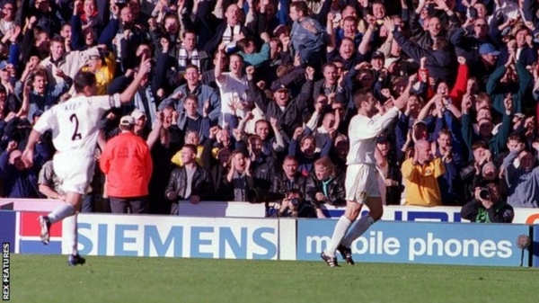 Mark Viduka (right) celebrates after scoring one of his four goals against Liverpool in 2000