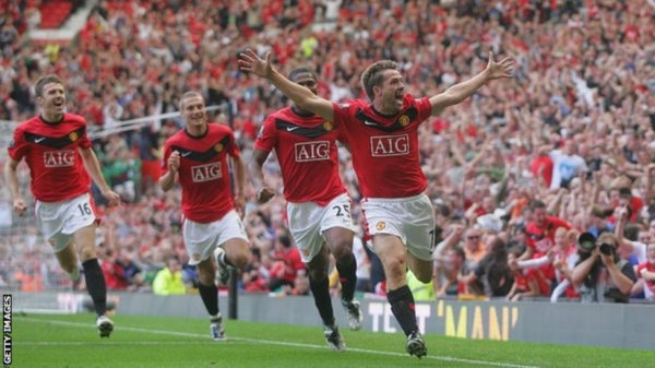 Michael Owen celebrates after scoring against Manchester City