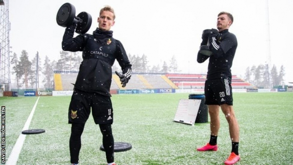 Ostersund players go through a weights session on their pitch
