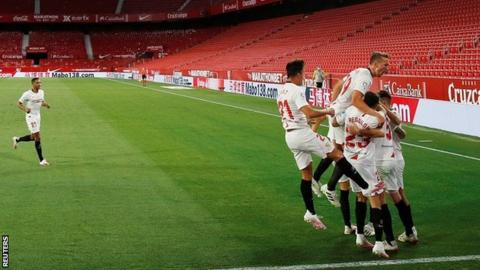 Sevilla celebrate their second goal